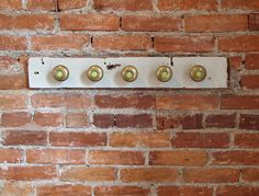 upcycled coat rack from door knobs, wine corks, and scrap wood