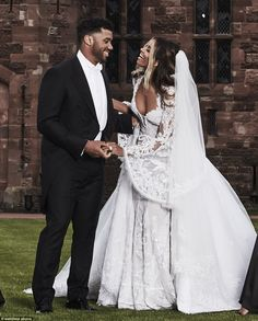 Ciara and Russell Wilson pose in front of a castle for their wedding photos | Daily Mail Online