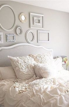 Not wild about the empty frames or frilly linens but the headboard and wall color are beautiful.
