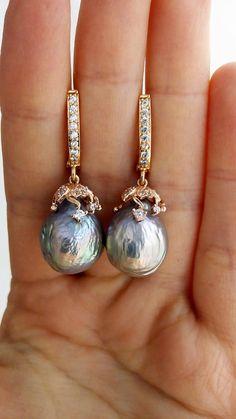 Silver baroque pearl earrings with metallic overtones