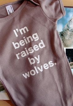 """Baby onesie: """"I'm being raised by wolves."""" Would it be even funnier if the font was more scrawl-like or the onesie was ragged? Cute Kids, Cute Babies, Funny Kids, Raised By Wolves, Everything Baby, Baby Fever, Future Baby, Onesies, Baby Onesie"""