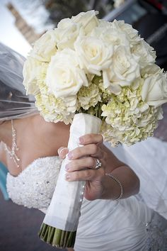White bouquet with hydrangea and roses. The stems are wrapped in satin. From bunchesdirect.ca.