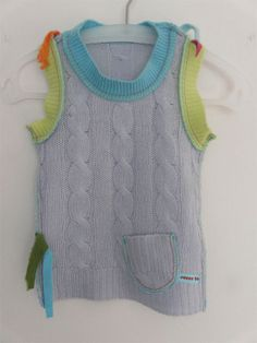 A beautiful and simple way to make new children's clothing from an old sweater.