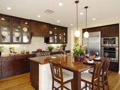 Cozy Kitchen: The island's countertop extension provides bar dining and a kitchen prep area. From HGTVRemodels.com