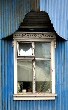 Little window, Reykjavik, Iceland, 2012, photograph by Eduardo Dacosta. - Due to weather conditions & lack of wood, the houses are usually covered with corrugated iron.