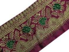 PRODUCT DESCRIPTION *****************************  * Vintage Sari Border/ Trim.  * Beautiful pure silk embroidered sari border with metallic gold & green color thread embroidery on Magenta base fabric.  * SALE FOR - 1 yard  * Width of the border is 1.2 approx.  * ITEM CODE - ST185  * CONDITION - Used  * COLOR - Magenta This is a vintage/used border and not new so can not be expected to be in perfect condition.  These are vintage saris and have been cut out from the vintage saris...