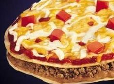 I love getting the Mexican pizza from Taco Bell. The perfect late night snack! It is really easy to prepare this at home and is a great dinner or snack idea to make when you have leftovers from a taco dinner.