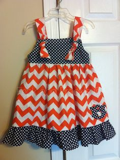 Hey, I found this really awesome Etsy listing at https://www.etsy.com/listing/164629883/auburn-tigers-chevron-knot-dress