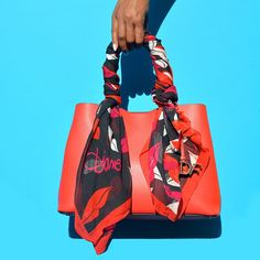 Color and glamour come together on the Voyage carryall and Eaden silk scarf. #MondayMood