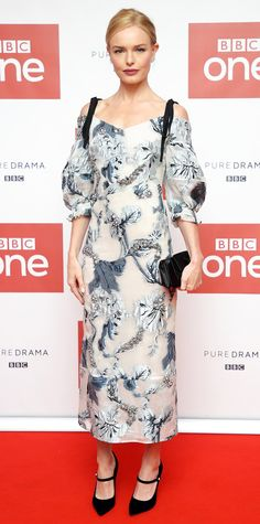 Leave it to Kate Bosworth to show us how brocade is really done. At the premiere screening of her new BBC One drama SS-GB, the actress stunned in a silver and blue ERDEM dress featuring an elegant off-the-shoulder cut and voluminous sleeves. The actress took a minimalist approach to accessories, opting out of a necklace and letting the collarbone-baring cut do all the talking. She topped off the look with glimmering rings, a simple black clutch, anLook of the Day - KATE BOSWORTH from…