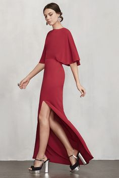 This is a ghost crepe maxi dress with batwing sleeves and a side slit. The back is open with a top strap and hook/zip closure.
