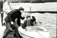 John Lennon and Paul McCartney on a boat in St Fillans, Perthshire, during the Beatles tour of Scotland (1964)