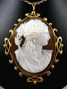 A Classical Beauty. Antique Victorian Cameo 15ct Gold Art Nouveau Pendant Brooch with Murrle Bennett style 15ct Gold whiplash gold mount and Master Carved Grand Tour Cameo.