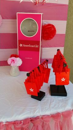 Miniature american girl logo bags used for candy table shopping.