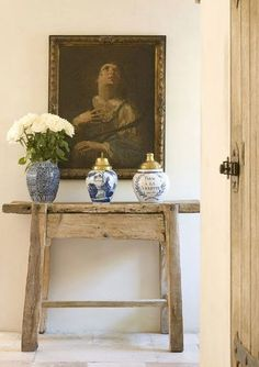 antique console table with antique art and ginger jar collection. great entry.