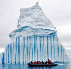 Striped icebergs occur when layers freeze without air bubbles, or with algae or other sediments in the ice.