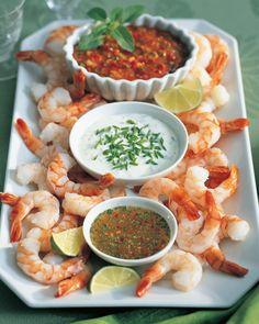three amazing dips for a cocktail shrimp platter - garlic lemon, cajun artichoke and chipotle sauces