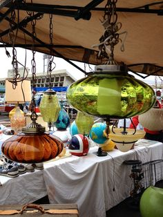 Terrific find. Five Swag Lamps at this flea market, Green, Amber, and White. Different shapes and Styles. I love these retro 1960s and 1970s hanging lights.