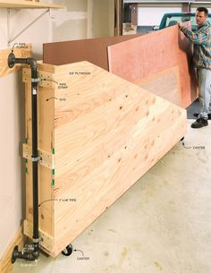 Swing-Out Plywood Storage - Woodworking Shop - American Woodworker. I could definitely use this in my studio