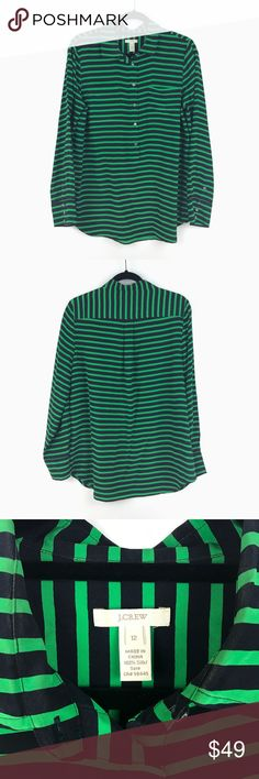 "J. Crew Polly Striped Silk Popover Blouse 12 262 J. Crew Polly Striped Silk Popover Blouse Women's Size 12 Green & Navy Top 262  Measurements: Bust:   20"" Flat Across Length:  28.5"" Long  Made of silk crepe de chine, dark navy stripe that almost looks like black.  In good preowned condition with no known flaws and light overall wear. J. Crew Tops Blouses"