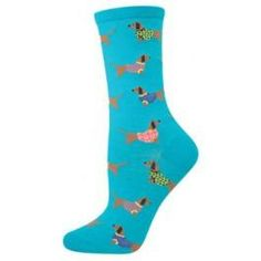 Some very fashionable dachshunds decorate these bright blue socks.  Check out those fancy patterned sweaters—your real dogs will be jealous!  Fits women's shoe size 5-10.5. 63% cotton, 34% nylon, 3% spandex.