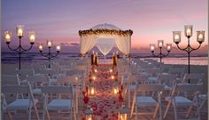 Sunset Wedding on the Beach - this is so incredibly beautiful. You could have a big white tent set up near by for the reception with white lights stung on the ceiling. Not to mention, the beach at night is so romantic!