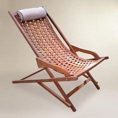 One of my favorite discoveries at WorldMarket.com: Wood Catania Swinger Lounger with Pillow