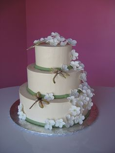 dragonfly wedding cake- I want something like this with pansies and the tiers off kilter. Oh and maybe in color?