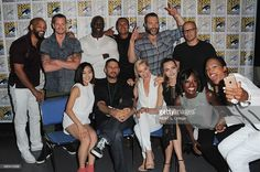 Actors Will Smith, Joel Kinnaman, Adewale Akinnuoye-Agbaje, Adam Beach, Jai Courtney, and Jay Hernandez; (L-R back row) actress Karen Fukuhara, director David Ayer, actresses Margot Robbie, Cara Delevingne, Viola Davis and moderator Aisha Tyler, taking a selfie, attend the Warner Bros. 'Suicide Squad' presentation during Comic-Con International 2015 at the San Diego Convention Center on July 11, 2015 in San Diego, California.