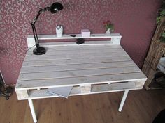 Desk range table from well-traveled industrial pallet .