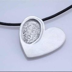 Baby fingerprint pendant: 2 cups flour 1 cup salt  Cold water  -mix until it has the constancy of play dough - Use a small cookie cutter to make the  heart shape Press your babies finger print into one side Bake at 250 for 2 hours. Let cool then spray it with metallic spray paint