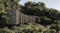 Vila Volcá welcomes you with a sense of discovery: you are entering an almost primitive ruin with its massive stone walls in the middle of a forest. A ruin-like house that tries to dissolve boundaries in order to develop the full potential of the void.