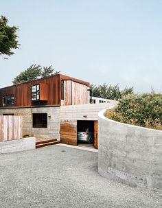 Cor-Tensteeland board-formconcretegive the exterior of this Sea Ranch, California home a weathered look.  Photo by: Mark Mahaney
