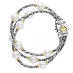 Three freshwater cultured pearl strands with Caviar beading in 18k gold and sterling silver on this statement bracelet. Finished with a signature double-button clasp detailing the LAGOS crest in 18k gold.