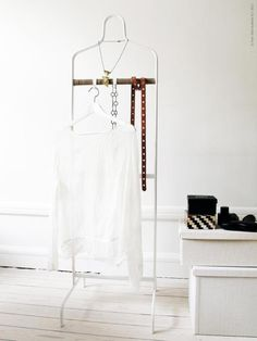 Ikea clothes valet....http://www.ikea.com/us/en/catalog/products/50219143/