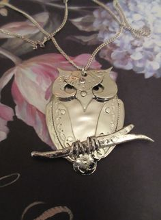 Salvaged bits of Sterling Silver Spoons fashioned into an adorable owl on a branch.