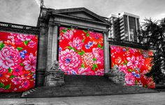 Taiwanese artist Micheal Lin painted this massive mural of peonies on a background of Taiwanese red covering most the Georgia Street side of The Vancouver Art Gallery.