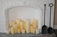 Candles in blocked fireplace. (Cupcakes and Cashmere) Candles In Fireplace, Fake Fireplace, Pillar Candles, Fireplace Tiles, Church Candles, Scented Candles, Home And Deco, My Living Room, Living Spaces