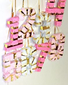 number pinatas pink and gold