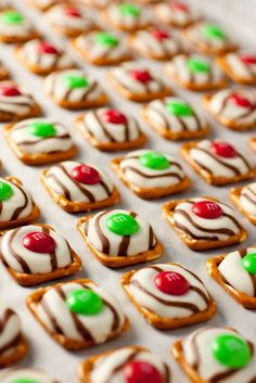 Made these last year  they are awesome. Preheat oven to 200 degrees.  Line baking sheet with parchment or silicone baking sheet.  Place Hershey Kiss on pretzel on baking sheet.  Heat 4-5 minutes (Kiss will still hold shape  it should not melt).  Remove from oven and top with MMs  Refrigerate until set  about 5 minutes.  Store in airtight container..