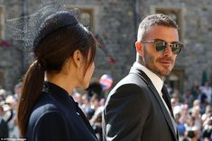 David Beckham sported a smart pair of sunglasses as the world-famous couple walked past cr...