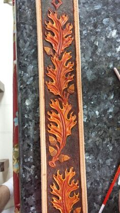 Guitar strap in progress. Tooled oak leaves and hand dyed.