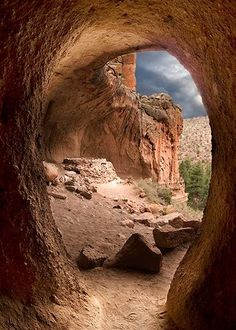 A reason to return to New Mexico.Kiva Bandelier National Monument, New Mexico. Check out those ominous (but awesome) clouds in the background. Amazing Places On Earth, Beautiful Places, Beautiful Life, Places To Travel, Places To See, Travel Destinations, Magic Places, Land Of Enchantment, Belle Photo