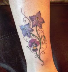 My 50th birthday present to me.  Ankle tattoo  birth month flowers - larkspur, violet, snowdrop