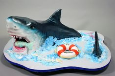 How To Make A Shark Birthday Cake With Circling Shark Birthday Cake To Produce Cool Shark Birthday Cake Decorations Ocean Cakes, Beach Cakes, Fisherman Cake, Shark Birthday Cakes, Cool Sharks, Movie Cakes, Shark Cake, Animal Cakes, Sculpted Cakes