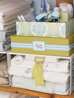 Prioritize Linens - love the ribbon straps around each sheet set!