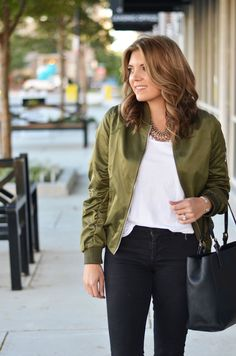 olive bomber jacket with jeans - green satin bomber jacket outfit | www.bylaurenm.com