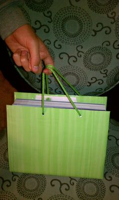 I recycled old gift bags for school book covers, with handles!
