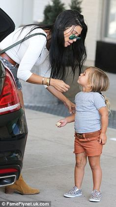 Mommy and me: Kourtney shared a sweet moment with daughter Penelope as she took her and Mason to Chuck E. Cheese's