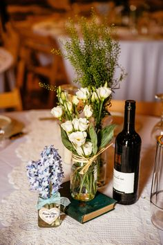 Lace table runner, glass jam jars filled with wild flowers including hyacinths -   Image by Cassandra Lane Photography - A Charlie Brear lace and silk dress for a west midlands vintage DIY barn wedding with a blue colour scheme and photography by Cassandra Lane